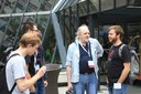 RIOTers discuss in front of the IETF 96 building